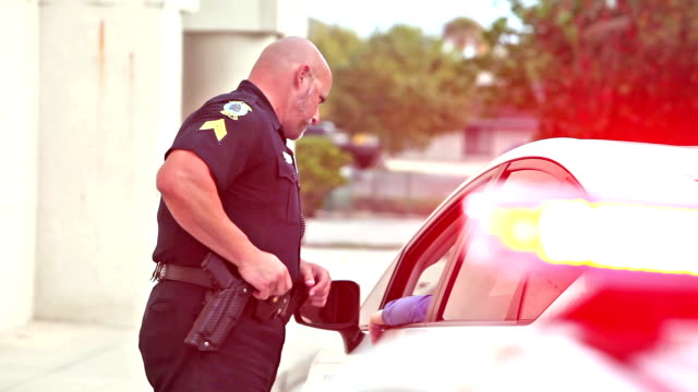 Police officer pulling over a driver