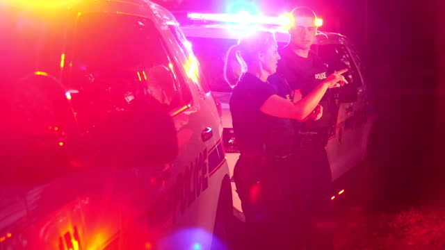 police officers at emergency scene, talking - police officer stock videos & royalty-free footage