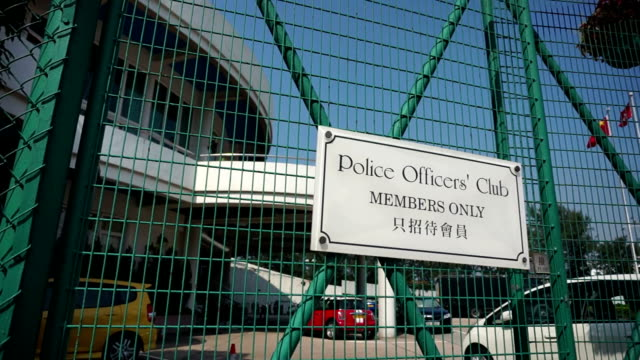 Police officers' club in Hong Kong Island, members only. A sign for the Police Officers' Club in Hong Kong with fence and flag in the background. police meeting stock videos & royalty-free footage