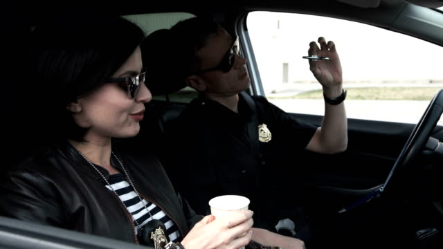 Police officers drinking coffee in car video