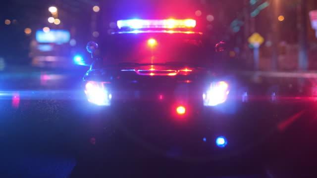 police patrol car at scene of emergency (optical lens defocus) - polizia video stock e b–roll