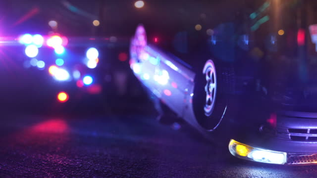 police patrol car at scene of emergency (optical lens defocus) - incidente video stock e b–roll