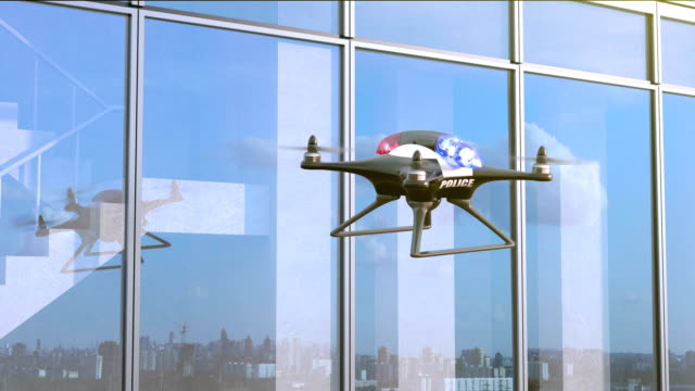 Police Quadcopter Patrols along the office building video