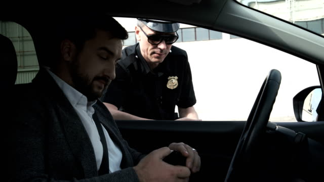 Policeman stopping a driver video