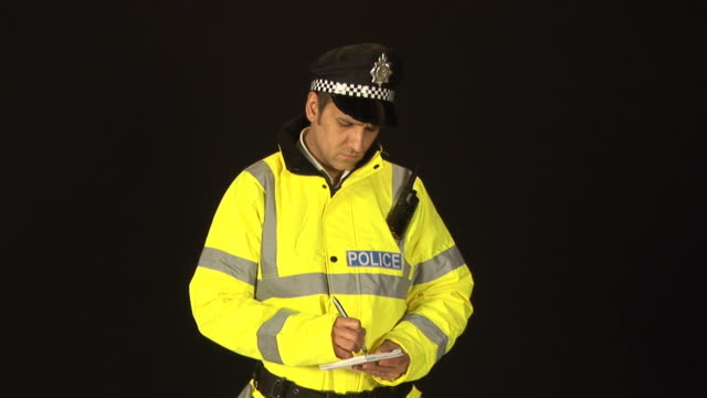 Policeman writing a ticket - HD & PAL video