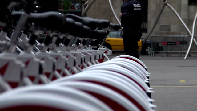 Policemen patrolling the city and providing security near bicycle parking video