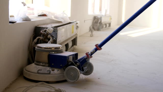 Polishing machine for floors closeup. Home renovation, parquet sanding, polishin. Man polishes the floors in the room. Repair of apartments in an expensive house Polishing machine for floors closeup. Home renovation, parquet sanding, polishin. Man polishes the floors in the room. Repair of apartments in an expensive house. handbook stock videos & royalty-free footage