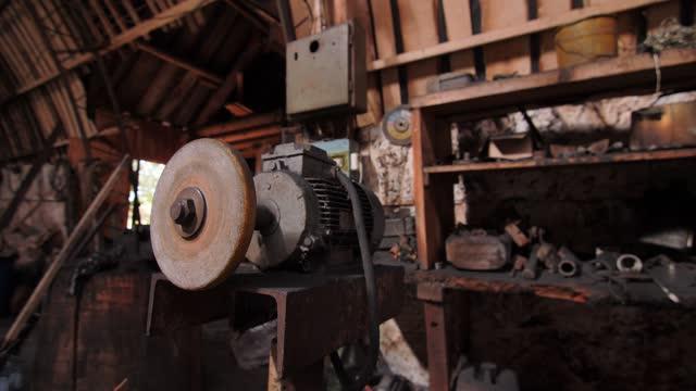 Polishing machine tool on workbench in woodwork shop