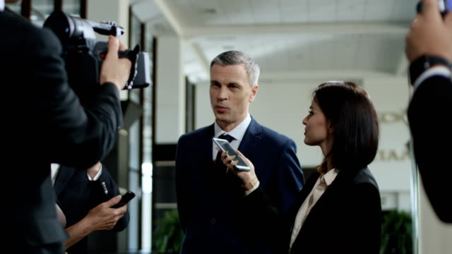 Politic man giving interview willingly