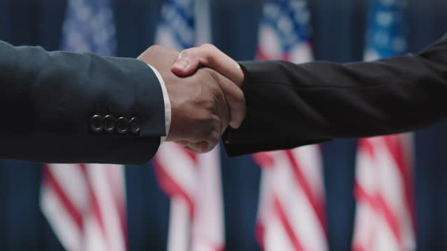 Politicians Shaking Hands Side view close-up shot footage of two unrecognizable candidates for USA presidency greeting each other with handshake president stock videos & royalty-free footage