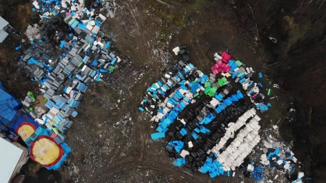 polluted landfill with colorful boxes on abandoned space video