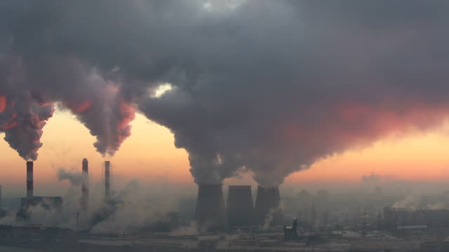 polluting factory at dawn - smog video stock e b–roll