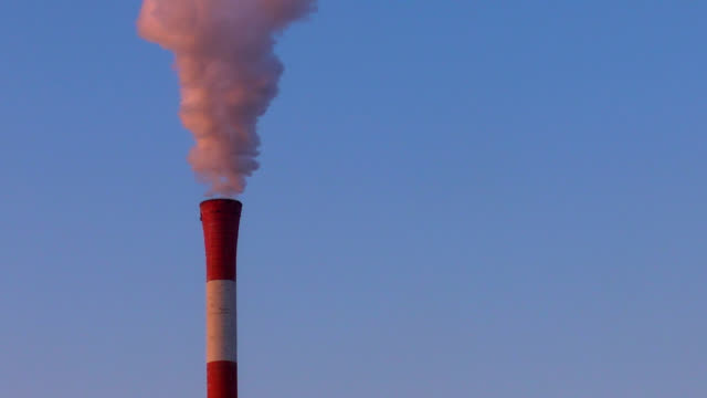 Pollution smoke from heating plant chimney video