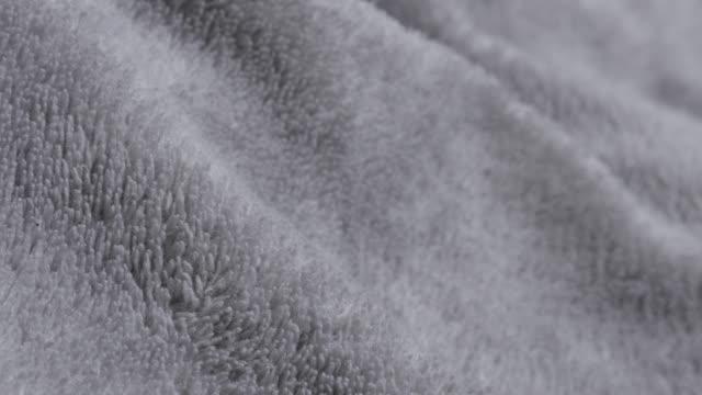 Polyester silver fleece polar fabric warm material  texture 4K 2160p 30fps UltraHD tilting footage - Slow tilt over silver synthetic fibers of polar blanket close-up 4K 3840X2160 UHD video