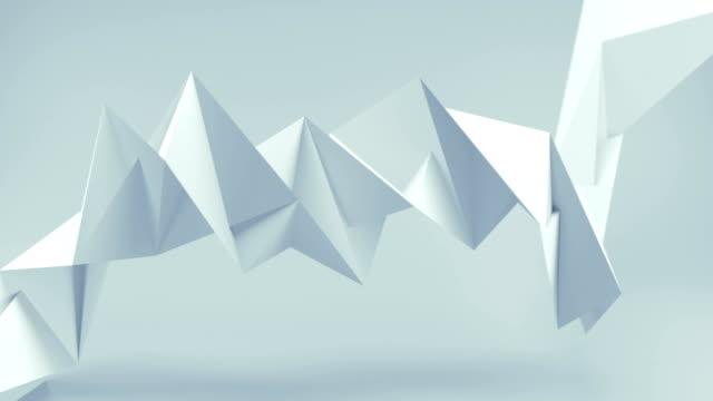 Polygonal white shape seamless loop 3D render animation Polygonal white shape. Abstract computer graphics. Seamless loop 3D render animation twisted stock videos & royalty-free footage