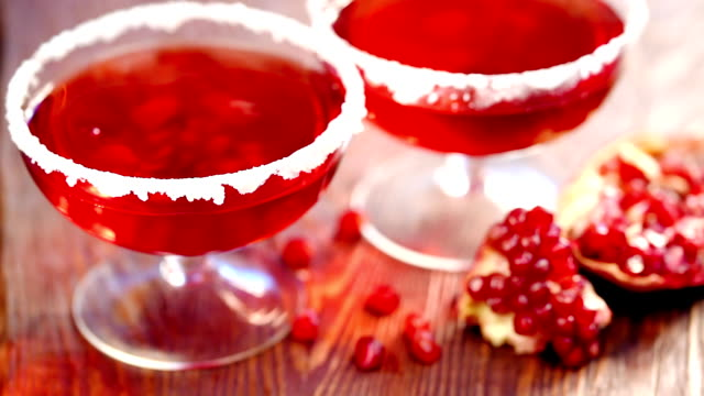 Pomegranate seeds fall into the glass with Pomegranate juice video