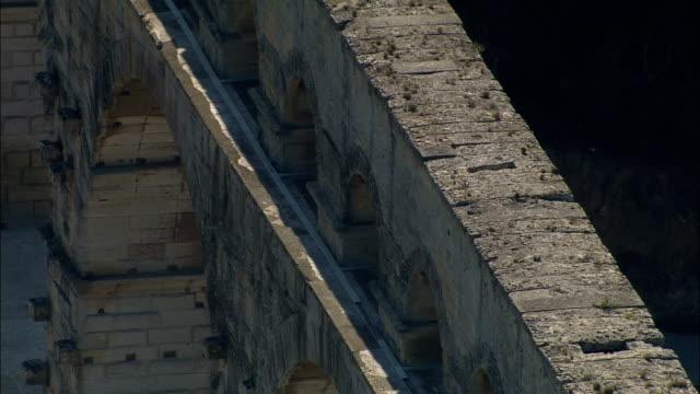 Pont Du Gard  - Aerial View - Languedoc-Roussillon, Gard, Arrondissement de Nîmes, France Pont du Gard - Roman bridge and aqueduct aqueduct stock videos & royalty-free footage