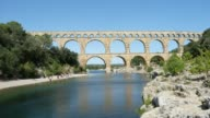 istock Pont du gard France landscape famous antique roman bridge landmark over gardon river 4k timelapse footage 1181931450