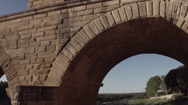 Pont Du Gard in golden sunrise Famous Provence Park, France aqueduct stock videos & royalty-free footage