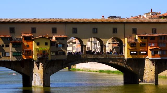 Ponte Vecchio Bridge and Arno River in Florence, Italy Ponte Vecchio Bridge and Arno River in Florence, Italy renaissance architecture stock videos & royalty-free footage