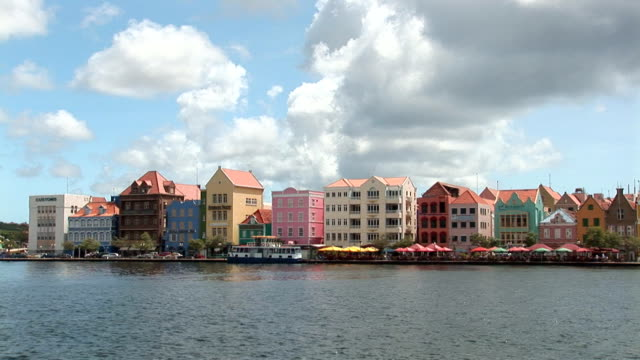 Pontoon bridge - pan right Pan to the right of the pontoon bridge in Willemstad, Curacao, Netherlands Antilles curaçao stock videos & royalty-free footage