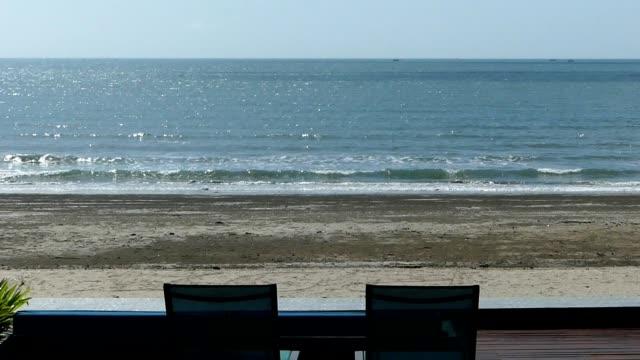 pool by the beach at hua hin sea, thailand - terrazza video stock e b–roll