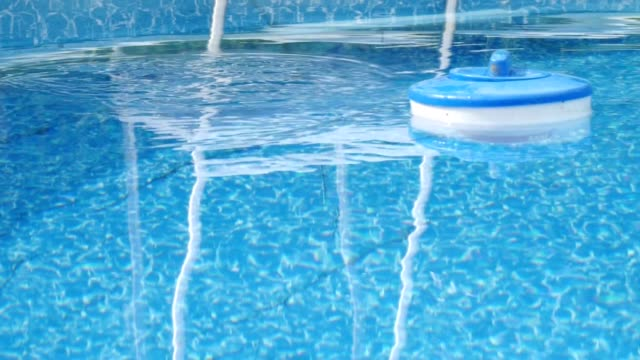 Pool maintenance Pool maintenance - float with the preparation for water treatment chlorine stock videos & royalty-free footage