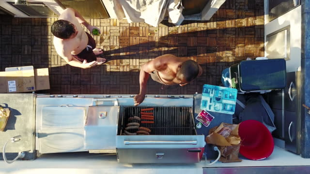 Pool Partygoers Drinking and Grilling Food video