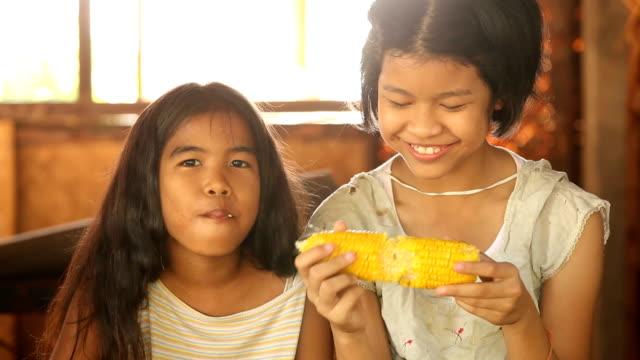 poor asian girls eating corn video