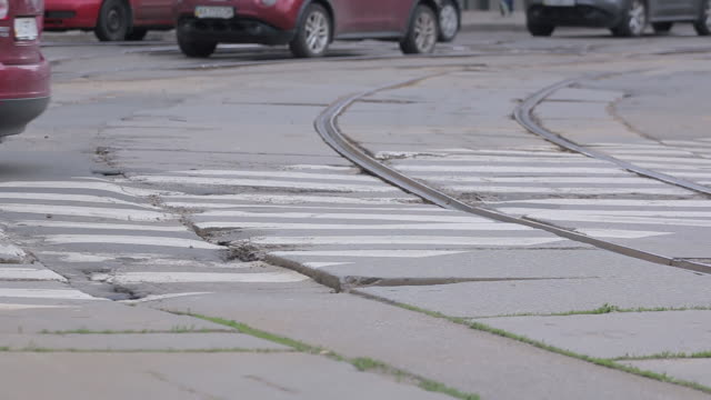 Poor condition of the road surface with tramway rails