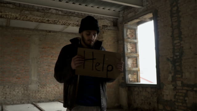 Poor dirty homeless with table 'help' video