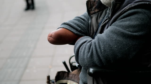 Poor disabled man asked money on street video