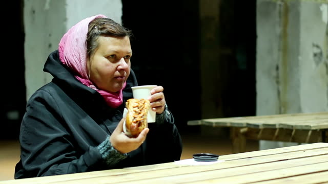 Poor lady having lunch at charity festival, help to socially video
