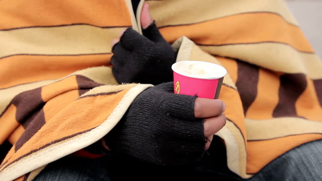 Poor man's hands holding paper cup for charity, goodhearted people giving money video