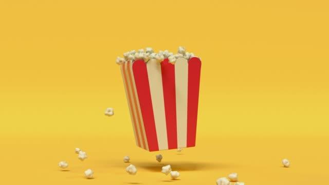 stockvideo's en b-roll-footage met popcorn box rood geel cartoon stijl minimaal 3d rendering cinema theater concept - popcorn