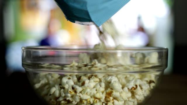 Popcorn falling into a bowl