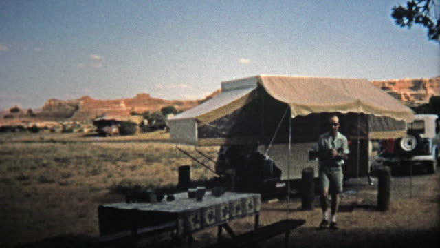1971: Popup trailer camping in the mesa wastelands. video