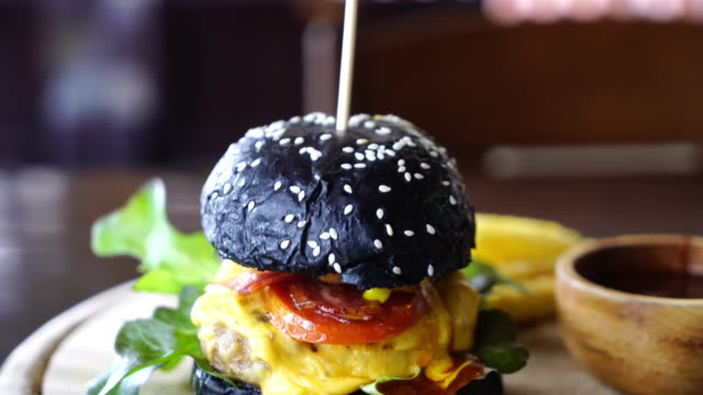 pork and cheese charcoal burger - burgers stock videos and b-roll footage