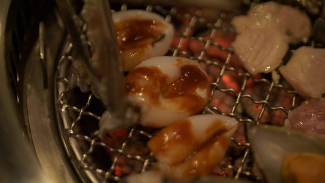 Pork and seafood barbecue grill video