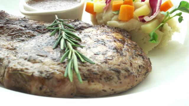 4K Pork chop steak video