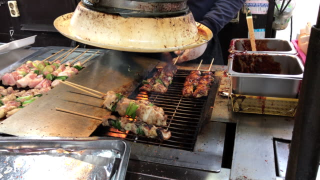 BBQ pork in Myeong-dong street , South korea video