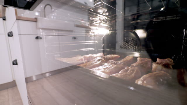 Pork meat in the oven. video