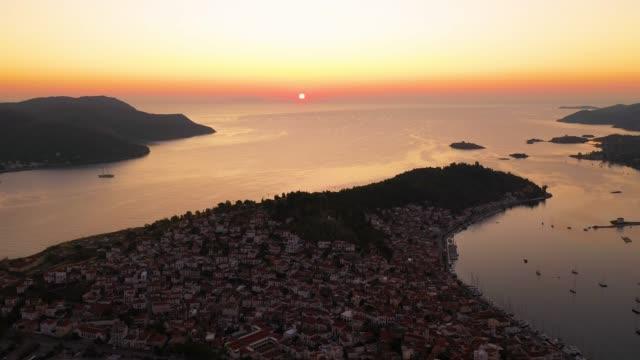poros ön i grekland. gryning med ett hav i - poros greece bildbanksvideor och videomaterial från bakom kulisserna