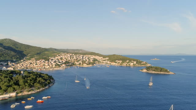 Port of Hvar in Croatia Aerial View Aerial view of the bay surrounding Hvar, a small island of Croatia close to Split. A popular tourist destination for European travellers coastal feature stock videos & royalty-free footage