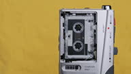 istock Portable Retro Tape Recorder with Micro Cassette Rec Sound on Yellow Background 1293993371