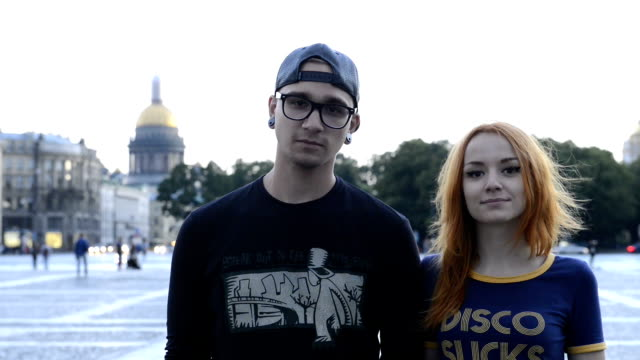 portert of stylish guy and girl on the background of the city st. petersburg - san pietroburgo russia video stock e b–roll