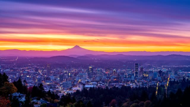 Portland autumn foliage and colorful sunrise behind Mt hood in time lapse with vertical panning video