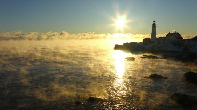 portland head lighthouse in arctic sea smoke - oceano atlantico video stock e b–roll