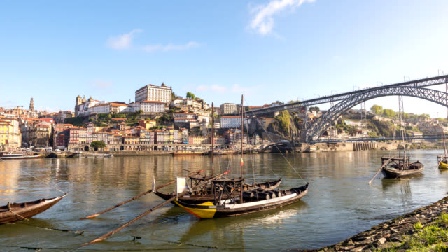 Porto Portugal time lapse 4K, city skyline timelapse at Porto Ribeira and Douro River with Rabelo wine boat