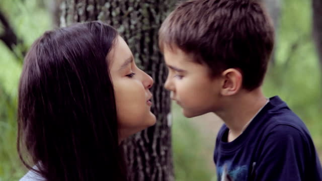 Portrait. A Little brothers and sister kiss and hugging loving hard each other video
